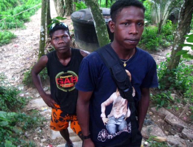 Глобализированные оранг асли в деревне Куала Тахан
